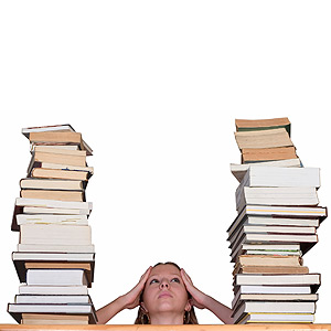 Woman sitting by piles of books
